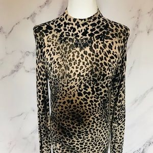Leopard print turtleneck sweater size medium